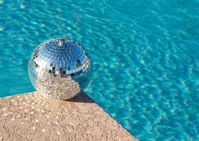 Disco ball beside resort swimming pool